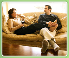 image of a couple sitting comfortably on a couch